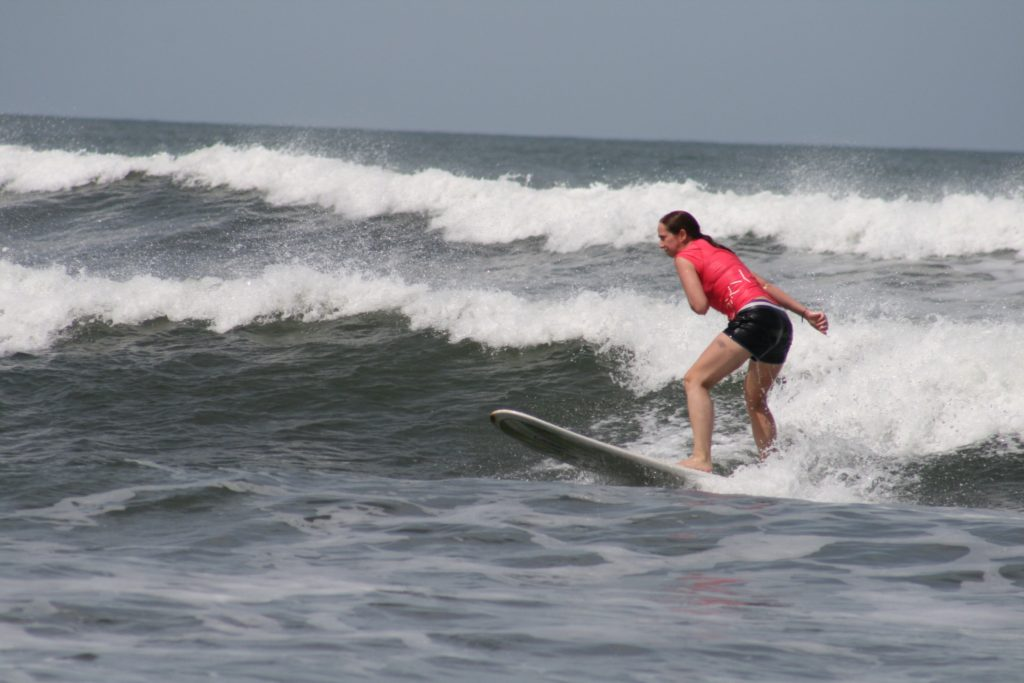 Here an Amiga can see that she really is putting too much weight back. Notice the nose of the surfboard up in the air.