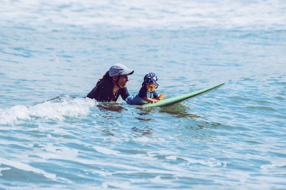 surfing with baby, baby on board, mother son surf session, protect the ocean, next generation