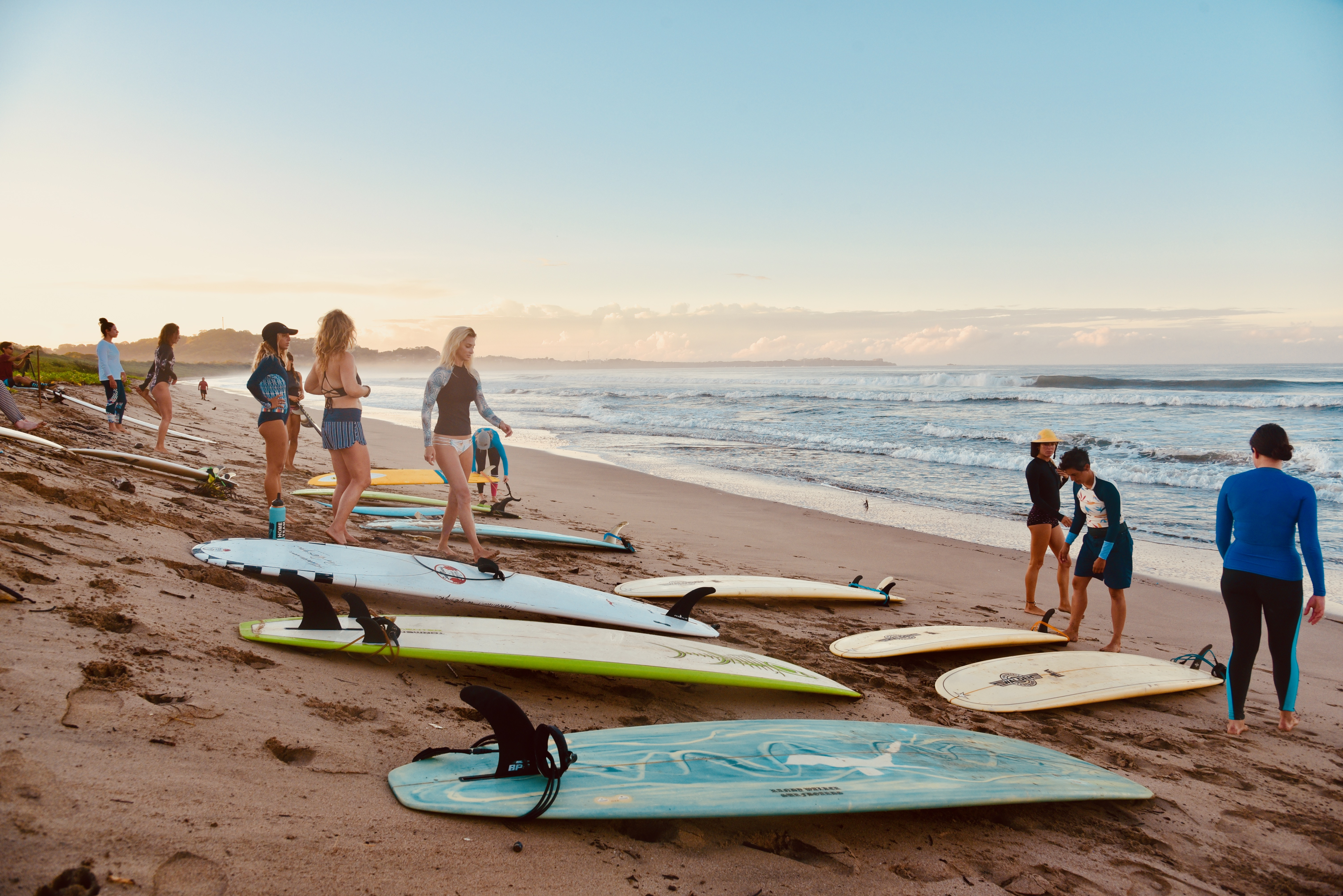 surf with amigas, playa grande, learn to surf, sunrise, beach, girls surfing