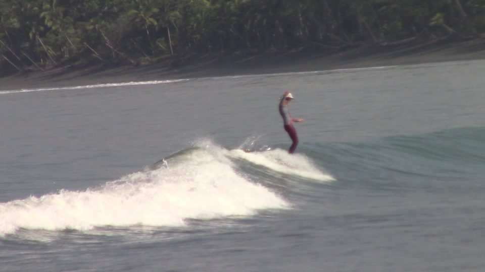 Jackie George, surf with amigas, long boarding, shredding, Costa Rica, surf camp, women surf yoga retreat
